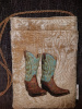 Large teal and brown boots on tan